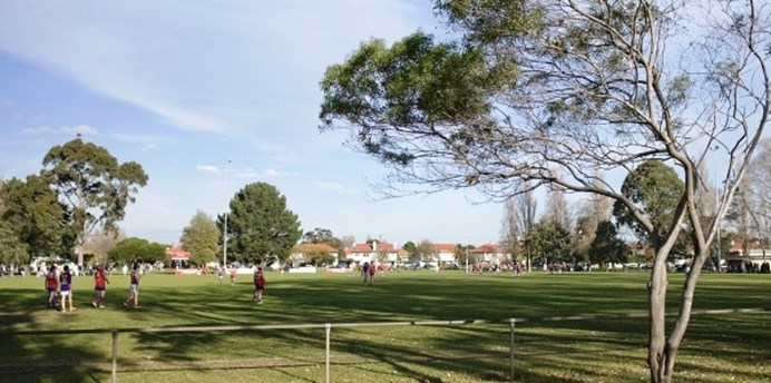 Local aussie rules game being played on JL Murphy Reserve