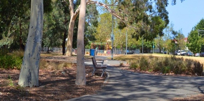 Hewison Reserve is accessible by paved paths and has seating, a playground, mature trees and grassy areas