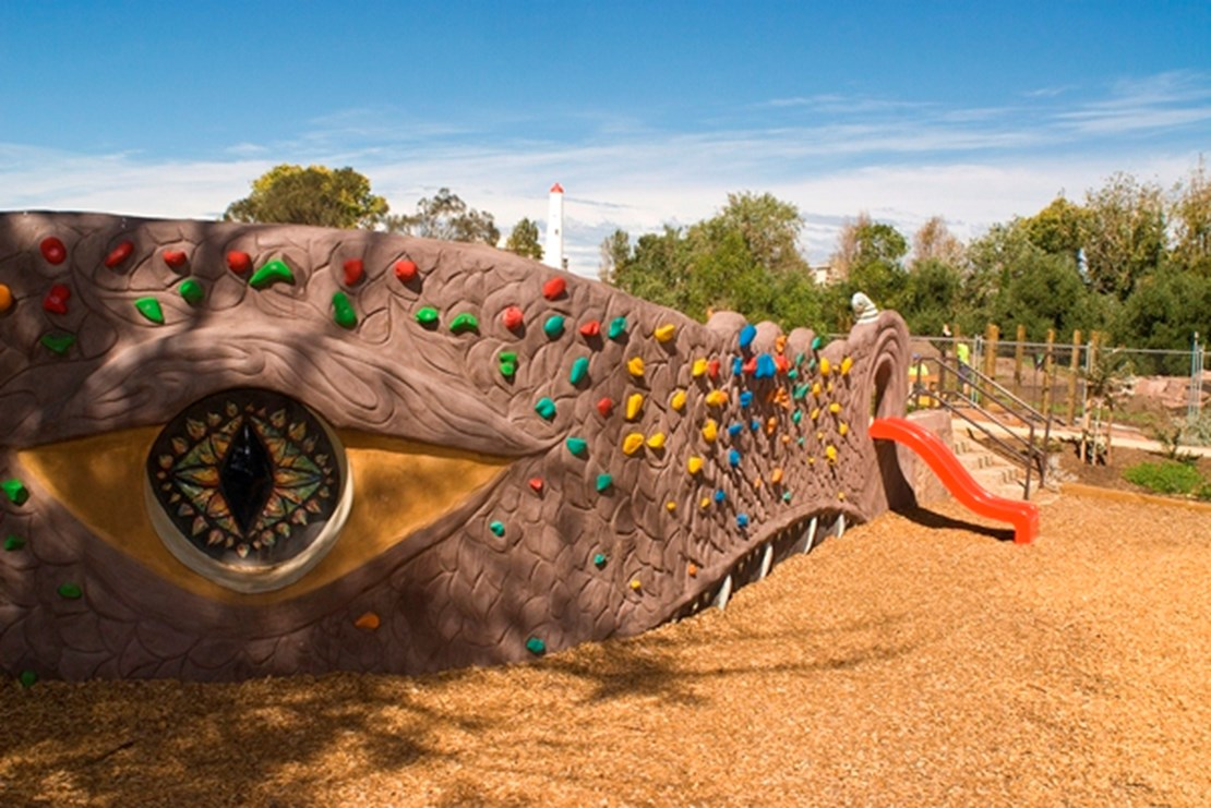 Playground facilities for use at Garden City Reserve designed around a dragons head