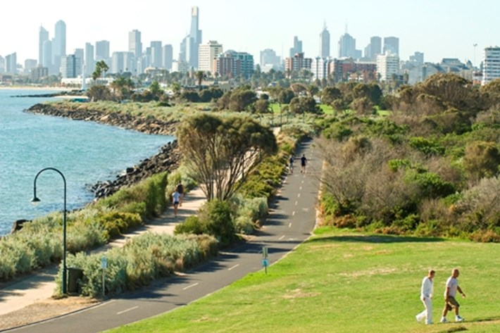 Looking across the bay towards the city skyline from the grassy hill of Point Ormond Reserve