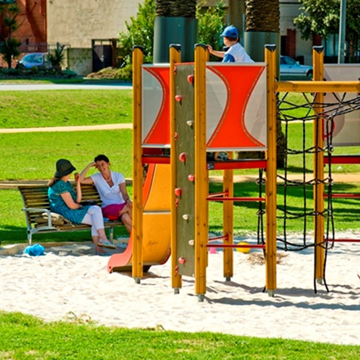 Playground facilities and bench seating available for use in Catani Gardens