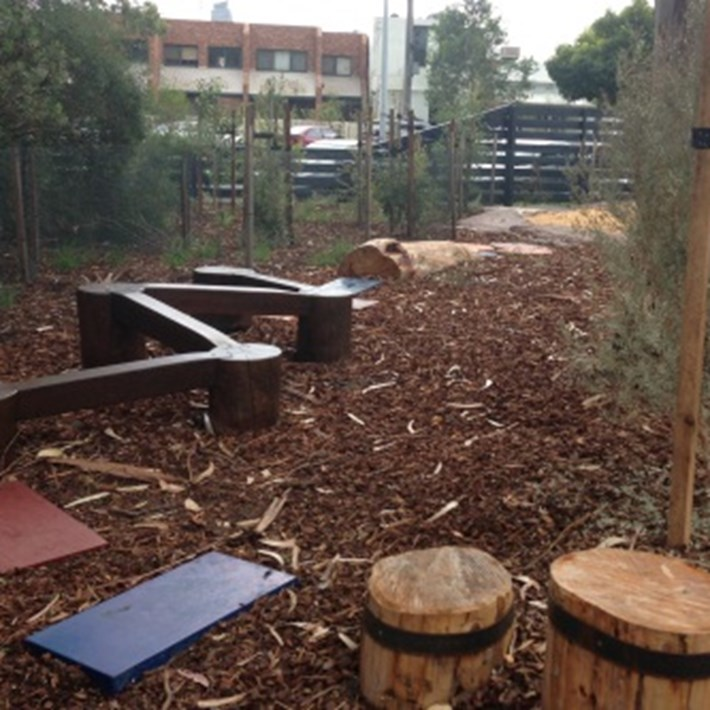 The playground includes log steps