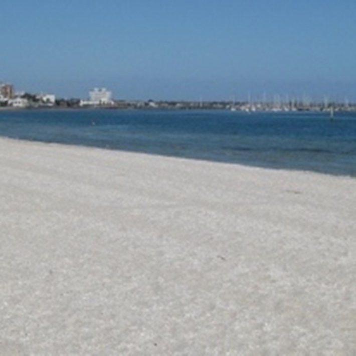Clear white sand and the Bay in Middle Park
