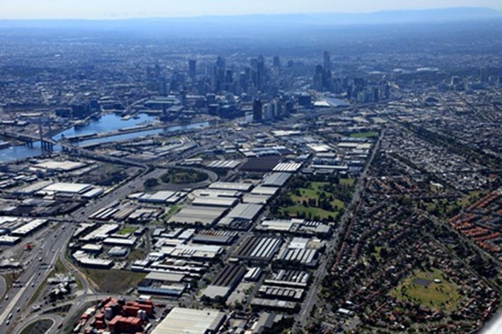 Aerial photo of the Fishermans Bend Urban Renewal Area in Melbourne, showing the industrial precinct of Sandridge and the Westgate Freeway